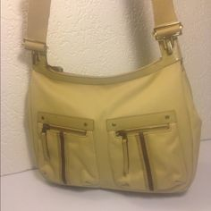 "Gucci Khaki Cross Body Messenger Shoulder Bag Gucci Khaki Cross Body Messenger Shoulder Bag ... Serial # 90762002113 ... Color: Tan ... Material: Khaki Canvas with Leather Trim ... Length: 12"" ... Height: 9.5"" ... Width: 3"" ... Strap drop: 23"" ... Guaranteed Authentic ... Features: Adjustable shoulder strap ... 2 Front zippered pockets ... Top zippered closure ... Zippered interior pocket ... Excellent preowned condition Gucci Bags Crossbody Bags"