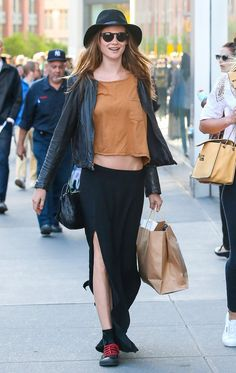 Behati Prinsloo went grunge in a black maxi skirt with a thigh-high slit, a cropped tee, black leather jack...