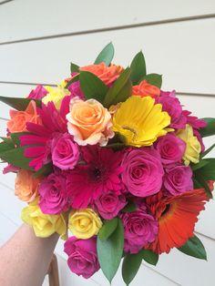 Bright wedding bouquet. Roses, gerbs, ruscus.