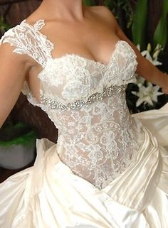 The bodice of this wedding dress is incredibly sexy; see-through lace bodice with one shoulder and sweetheart neckline...I wish I could see the rest of this dress! It looks like it's a satin