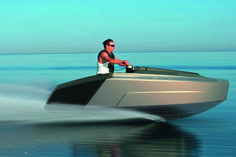 Audi's concept design studio in Munich came up with an interesting proposition for a luxury yacht that would wear the four-ring logo.  The Audi Trimaran is a new concept which integrates two jet skis in a motorboat.  The Trimaran is 15 meters long and 6.4 meters wide due to its slender center hull. The boat can accommodate 12 persons on the deck, with six berths available in the lower compartment.