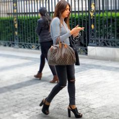 There's a uniform to #Paris and it includes a #LouisVuitton bag iPhone black skinny #jeans and a #leather jacket #pfw  #style #fashion #streetstyle #stylespotting #glamhive