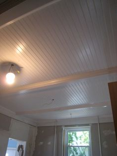 basement ceiling idea. remove drop ceiling, paint beams white and put up bead board panels between beams.