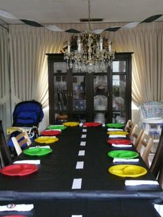 Car Theme Party ~ Add white stripes to an inexpensive black table cloth, use green, yellow and red plates Source: ashbaygrammy Hot Wheels Birthday, Hot Wheels Party, Race Car Birthday, 2nd Birthday, Birthday Ideas, Car Themed Parties, Cars Birthday Parties, Car Themed Birthday Party, Disney Cars Party