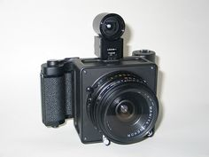 Custom machined camera body to accept 50mm Mamiya press lens and 6x9 back.