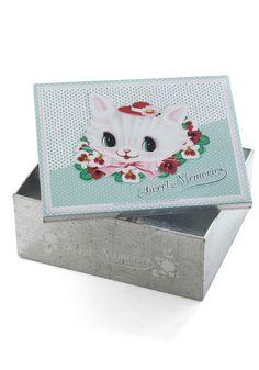 Tin box with art by Fiona Hewitt of Wu & Wu