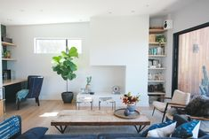 shelving, coffee table, chair, fireplace, desk, fig tree!  A Q&A with Cleo Murnane, designer and founder of architecture firm Project M Plus, whose Silver Lake home was her biggest labor of love yet.