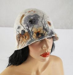 Felted Hat Art Hat wild Retro hats Felt wearable art Nunofelt Nuno felt la belle epoque Eco art deco Fiber Art    Much more beautiful than the picture! A hat from our workshop.  A feminine and gorgeous piece of art - it will emphasize your individuality!    Elegant and very flattering hat. Hand felted on and with silk (Nunofelt). Adapts to the head, it can be fancifully shaped and worn in countless ways. Full of motion, sophisticated, elegant, harking back to classics, but... A rebellious…