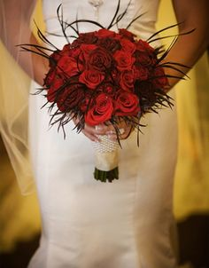 Chocolate Feather and Red Rose Bouquet. Robin Red Breast Wedding