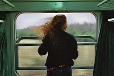 Sticking her head out of the train window, she closed her eyes and let the wind vlow over.her face.