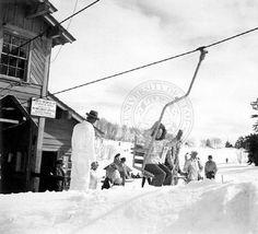 Skiers boarding the Ogden City lift :  : Univ of Utah - Multimedia Archives Photographs    Skiing, Ski, Utah, Ogden, Snowbasin, Snow Basin, Wild Cat single chair lift.