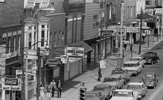 July 20, 1967: West Union Street was bustling with activity and business. Campus Sundry, Pipe Dreams, Vere Smith, Western Union, Jimanott's Spaghetti, Townhouse Grill, Carrol's Market, The Nut Shop and Cornwell Jewelers can all be seen. The Union is also represented although its sign cannot be viewed.