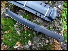 """The Cold Steel Recon Tanto features a 7"""" tanto blade made of AUS8A stainless steel, 3/16"""" thick, with a non reflective black Teflon finish. The deeply checkered black Kraton handle, 4.75"""" long, has an integral guard and a lined lanyard hole. A Secure-Ex sheath with multiple grommets and lashing slots is included."""