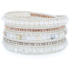 $220 | Accessorize yourself this season with this stunning wrap bracelet. Included in this bracelet are white Freshwater pearls, silver shade SWAROVSKI® crystals, white opal semi-precious stones and plated nuggets. The elements found in this style are crafted onto a strand of pearl leather that beautifully compliments the hues of this versatile wrap.