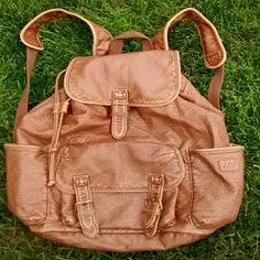!!!!HP!!!! Backpack Caramel Colored. Has a soft, worn, vintage look. Bottom of bag has a discoloring to it. Shown in pic 3. Aeropostale Bags Backpacks