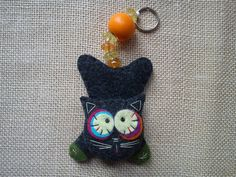 A keychain made of felt, a black cute cat. Perfect for keys, or simple as a hanging decoration.