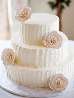 a white buttercream wedding cake