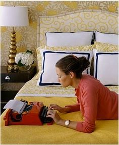 Love the yellow, the brass lamp, black trim, watch, and (of course) typewriter.  Via elementsofstyle