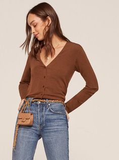 Don't be so cold. This is a relaxed fitting, button front sweater with a v neckline.