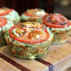 A cheesy muffin with cheddar and feta and spinach, topped with thinly sliced tomatoes. There's thyme in there too! There are a few st...