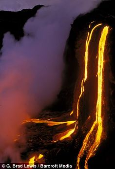 Lava flowing into Pacific Ocean, after flowing seven miles downhill from the vent of Kilauea Volcano