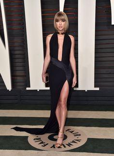 Taylor Swift: Alexandre Vauthier haute couture dress; Lorraine Schwartz ring; Jimmy Choo clutch; Giuseppe Zanotti heels