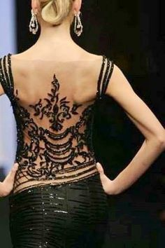 Stunning black Chanel gown. The detail on this gown is so amazingly beautiful!