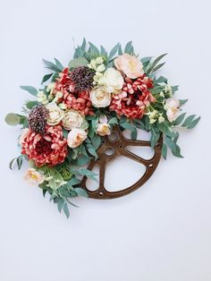 A unique find! This vintage movie reel is topped with large deep-mauve mums, purple berries, cream roses, and pale pink wild poppies! Movie Reels, Film Reels, Wild Poppies, Cottage Style Decor, Cream Roses, Craft Night, Flower Centerpieces, Vintage Movies, Our Wedding