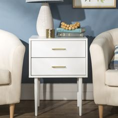 White side table with 2 drawers and golden handle details. Discover our wide range of side tables at Furniture123. #sidetable #whitesidetable #whitetable #whitelivingroom #livingroomdecor #homedecor #homestyle #sidetable #sidetablewithstorage Large Furniture, New Furniture, Online Furniture, Living Room Furniture, Home Living Room, Living Room Decor, White Tv Unit, White Tv Stands, White Sideboard