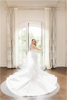 bride poses in window of bridal suite looking over shoulder at Park Chateau Estate | Elegant summer wedding at Park Chateau Estate with ivory and pastel details photographed by New Jersey wedding photographer Idalia Photography. Planning a Park Chateau Estate wedding? Find inspiration here! #IdaliaPhotography #ParkChateauEstate #SummerWedding Bridal Suite, Bridal Robes, Bridal Dresses, Bridesmaid Dresses, Nj Wedding Venues, Wedding Morning, Bride Poses, Wedding Gallery, Intimate Weddings