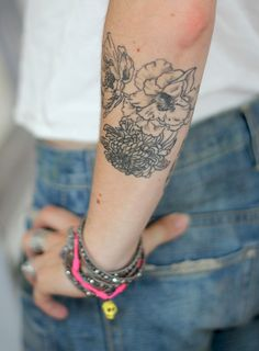 flower tattoo...when I grow up and get a real job that will allow me to have many tattoos I'm going to get my flower sleeve!
