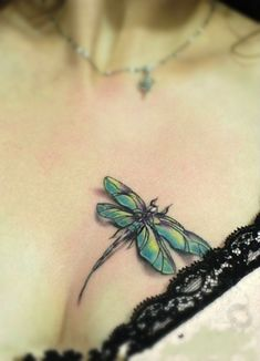 Dragonfly tattoo design on the chest