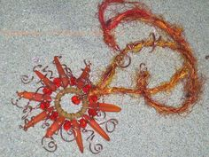 """Soleita"" cultured sea glass necklace- a ZnetShows design challenge winner - shown at Tuscon gem show 2013 https://www.etsy.com/listing/170355801/solieta-wireworked-sea-glass-sun?ref=shop_home_active"