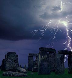 Lightning strikes over Stonehenge in Wiltshire, England.