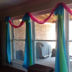 Party Decor!  Just cut the cheap plastic table cloths long ways for giant streamer like curtains... For the valance, I just taped the narrow ends together with clear tape.