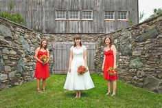 The bridal party poses by the great stone wall during a rustic chic wedding held at the Historic Barns of Nipmoose. Photography by Keira Lemonis
