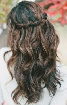 We love this waterfall wedding hair look. It's relaxed enough for your bridesmaids too