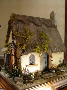 Rik Pierce makes charming miniature houses and is an amazing teacher. Create the Cottage in a class in Cleveland in April 2014 !!!!