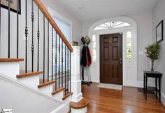 Entryway and wrought iron staircase inspiration