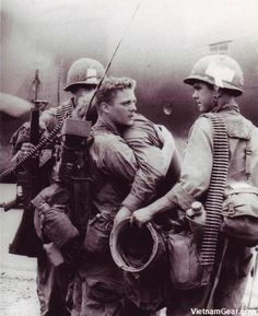 A radioman comforts his friend who just survived a battle during Operation Byrd in which nearly his entire platoon was wiped out Co. A, 2/7, 1st Cav. Div.  1966. via reddit