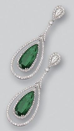 PAIR OF EMERALD AND DIAMOND PENDANT-EARRINGS. The tops set with 2 small pear-shaped diamonds weighing approximately carat with frames of small round diamonds, supporting swing pendants set with 2 pear-shaped emeralds weighing approximately carats, Emerald Pendant, Sapphire Earrings, Emerald Jewelry, Pendant Set, Diamond Pendant, Gold Jewelry, Antique Jewelry, Vintage Jewelry, Vintage Earrings