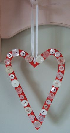 Button heart.....could even use card wrapped in ribbon as the backing. Or even edge a wooden heart with buttons after covering in paper/paint.