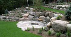 flagstone patio with firepit and built-in boulders - just lower level of borders would be great for built-in seating | Retaining Walls | Pinterest | Patio, Fir…