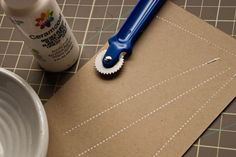 Faux stitching: quilter's wheel dipped in acrylic paint. how cute for stamping & cards!
