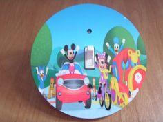 Disney MICKEY MOUSE CLUBHOUSE #2 Light switch Cover 5 Inch Round (12.5 cms) Switch plate Switchplate by Character Creations. $12.00. Disney Mickey Mouse Clubhouse Design. Large 5 inches (12.5 cms) Lightswitch Cover. Beautifully finishes off any room. NOT a Sticker.  Image is heat sealed into the switchplate, therefore is completely washable.. Hardboard with Beautiful Glossy Finish. This is a fantastic addition to any bedroom or playroom and is made from hardboar...