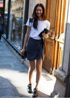 mini skirt + white shirt + tucked in + sling bag: Asian, minimalist, airport wear