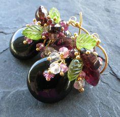 Black onyx, garnet earrings peridot leaves pink tourmaline white topaz gold vermeil cluster dangle woodland fairy bramble secret garden. $102.00, via Etsy.