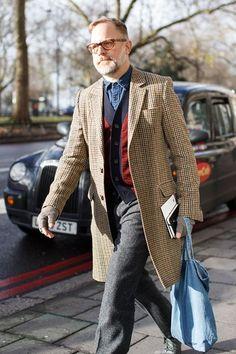 Bruce Pask, fashion director, New York Times Wearing vintage glasses, an Ami coat, Jil Sander cardigan, J Crew trousers, Save Khaki gloves ...