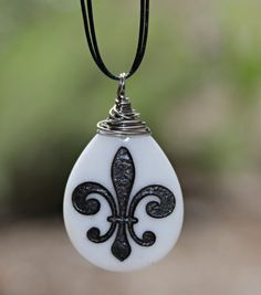 Fleur de lis engraved stone pendant necklace by Terra Rustica Design. http://www.etsy.com/shop/terrarusticadesign