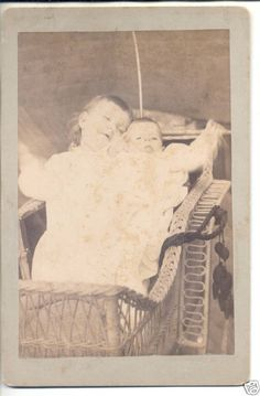 Fantastic cabinet card. Is it a Momento Mori? The older child does have a very slack face, but is he/she dead? Is the blurring arm caused by the baby having jarred it? It was listed as PM, and indeed placing a dead sibling with alive ones was a common tableau for a memorial photo. Anyone want to wade in on this one?